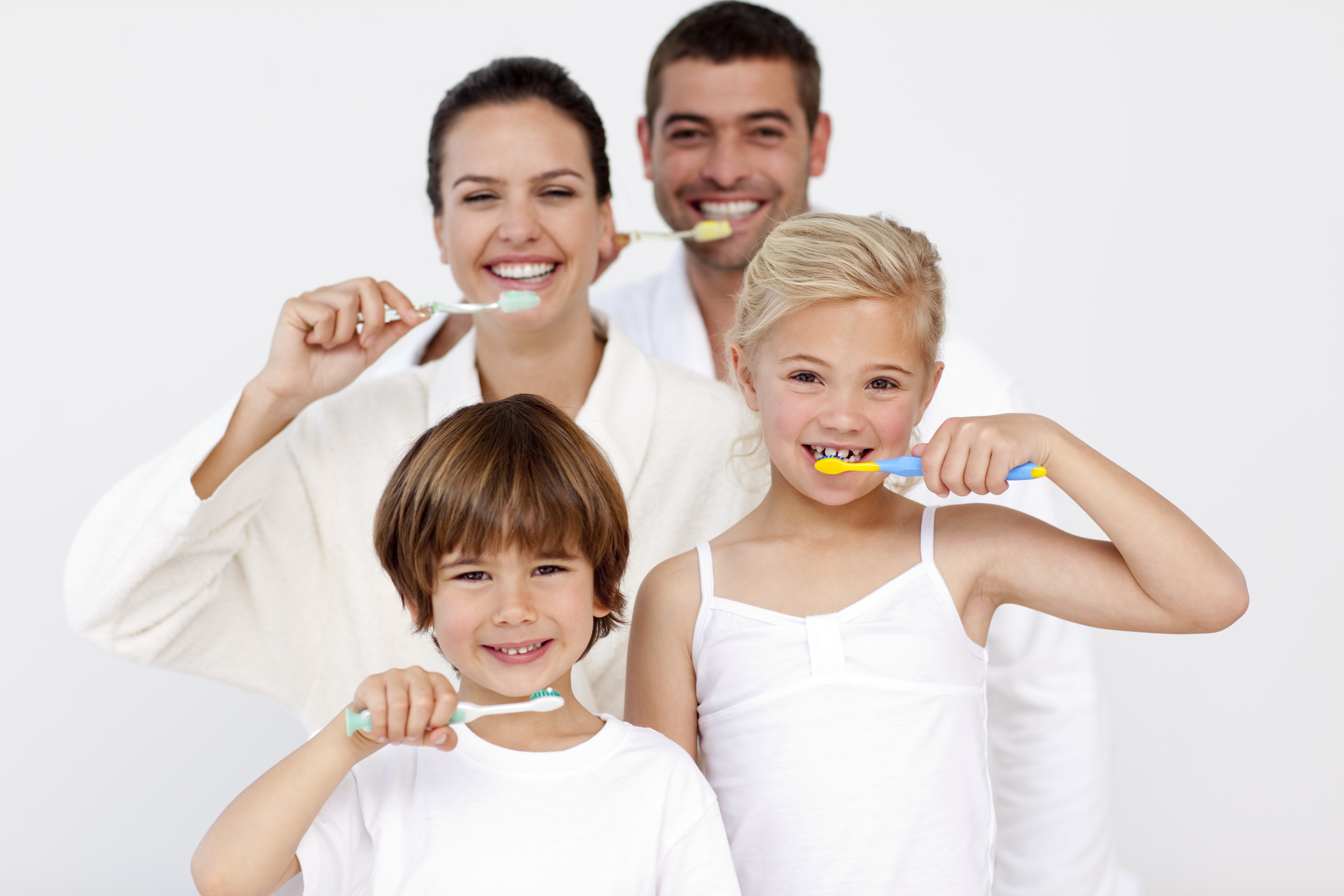 Family smiling and brusing teeth